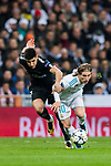Luka Modric (R) of Real Madrid fights for the ball with Yuri Berchiche of Paris Saint Germain during the UEFA Champions League 2017-18 Round of 16 (1st leg) match between Real Madrid vs Paris Saint Germain at Estadio Santiago Bernabeu on February 14 2018 in Madrid, Spain. Photo by Diego Souto / Power Sport Images