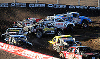 Nov. 6, 2010; Las Vegas, NV USA; LOORRS pro two unlimited driver Robby Woods (99) leads Carl Renezeder (17) during round 13 at the Las Vegas Motor Speedway short course. Mandatory Credit: Mark J. Rebilas-
