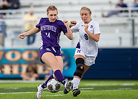 Leah  Martin (14) of Fayetteville and Ava Mc Crary (9) of Mount Saint Mary's Academy fight for ball at Wildcat Stadium, Springdale, Arkansas, Friday, May 14, 2021 / Special to NWA Democrat-Gazette/ David Beach