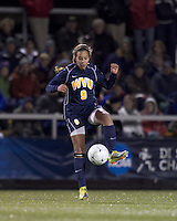 """West Virginia forward Frances Silva (9) traps the ball. Boston College defeated West Virginia, 4-0, in NCAA tournament """"Sweet 16"""" match at Newton Soccer Field, Newton, MA."""