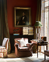 The portrait of a 19th century musician is the focal point of this wall in the study