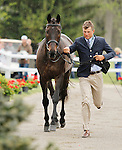 LEXINGTON, KY - APRIL 27: #45 Shamwari 4 and rider Boyd Martin, jog before the vets and grand jury during the first horse inspection for the Rolex Three Day Event on Wednesday April 27, 2016 in Lexington, Kentucky. (Photo by Candice Chavez/Eclipse Sportswire/Getty Images)