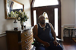 Curtis Milsap, a survivor of police torture carried out by detectives working under former Chicago Police Commander Jon Burge, sits in a wheelchair, the result of a car accident he had shortly after his release from being wrongfully incarcerated for about three years in the early 1990s, in the foyer of his home in Vossburg, Mississippi on June 22, 2016.  Milsap was chained to a file cabinet by police and repeatedly kicked and punched, ultimately beaten so badly that he required six months of outpatient care for his testicles while in custody and awaiting trial due to the damage that resulted from the beating he endured and he is also a recipient of a $100,000 reparations check from the City of Chicago.