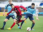 Forfar Athletic v St Johnstone....08.02.14   Scottish Cup 5th Round<br /> Omar Faero holds off Michael O'Halloran<br /> Picture by Graeme Hart.<br /> Copyright Perthshire Picture Agency<br /> Tel: 01738 623350  Mobile: 07990 594431