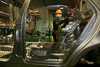 Workers operating on the assembly line of Geely Automobile Holdings LTD in Ningbo, China. Along with other auto makers in China, Geely is now looking overseas to sell its vehicles as stock increases and domestic margine declines. China is currently the world's 4th largest auto maker, plans to boost vehicle and automobile components exports by 15 folds to more than 120 billion yuan (15 billion US) in the next 10 years..
