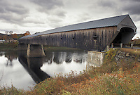 AJ4604, covered bridge, fall, wooden bridge, Vermont, New Hampshire, Connecticut River, The Windsor-Cornish Covered Bridge c.1866 spans the Connecticut River connecting the states of Vermont and New Hampshire. It is one of the longest covered bridges in the nation.