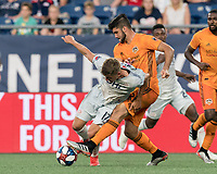 FOXBOROUGH, MA - JUNE 29: Justin Rennicks #12 attempts to control the ball as Alejandro Fuenmayor #2 pressures during a game between Houston Dynamo and New England Revolution at Gillette Stadium on June 29, 2019 in Foxborough, Massachusetts.