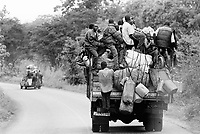 """Guinea. State of """"Guinée Forestière"""". Guinean men on their way by truck to Kissidougou. Trucks and cars are usually loaded with people and goods. Daily life. © 2001 Didier Ruef"""