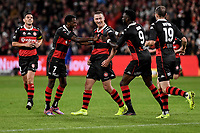 1st May 2021; Bankwest Stadium, Parramatta, New South Wales, Australia; A League Football, Western Sydney Wanderers versus Sydney FC; Mitch Duke of Western Sydney Wanderers is congratulated by Bruce Kamau and Bernie Ibini of Western Sydney Wanderers  after scoring to make it 2-0 in the 16th minute