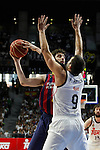 Real Madrid´s Felipe Reyes and Barcelona´s Tomic during Liga Endesa Final first match at Palacio de los Deportes in Madrid, Spain. June 19, 2015. (ALTERPHOTOS/Victor Blanco)