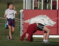 NWA Democrat-Gazette/J.T. WAMPLER Kenlee Morris, 10, performs a back-bridge while playing Sunday Sept. 13, 2015 with her friend Kylie Mollner, 10, both of Fayetteville before Arkansas' soccer game against University of Missouri-Kansas City.