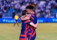 SAN PEDRO SULA, HONDURAS - SEPTEMBER 8: Brenden Aaronson #11 and Antonee Robinson #5 of the United States hug after a game between Honduras and USMNT at Estadio Olímpico Metropolitano on September 8, 2021 in San Pedro Sula, Honduras.