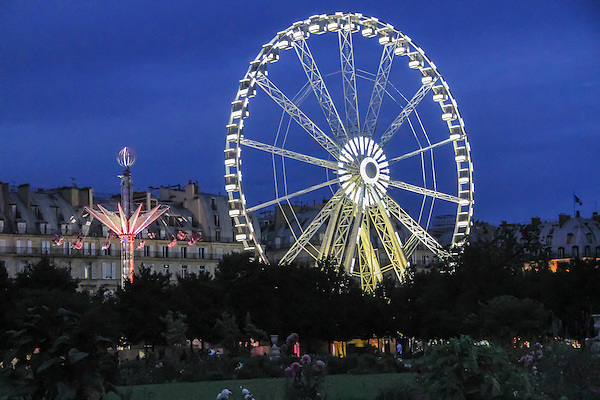 Ferriswheel in Tulieres Gardens at night, Paris, France .  John offers private photo tours in Denver, Boulder and throughout Colorado, USA.  Year-round. .  John offers private photo tours in Denver, Boulder and throughout Colorado. Year-round.