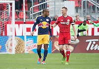 Toronto, Ontario - May 17, 2014: Toronto FC defender Steven Caldwell #13 talks with New York Red Bulls forward Thierry Henry #14 during a game between the New York Red Bulls and Toronto FC at BMO Field. Toronto FC won 2-0.
