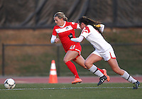 COLLEGE PARK, MARYLAND - April 03, 2013:  Stephanie Ochs (22) of The Washington Spirit races for the ball with Erika Nelson (15) of the University of Maryland women's soccer team in a NWSL (National Women's Soccer League) pre season exhibition game at Ludwig Field in College Park Maryland on April 03. Maryland won 2-0.