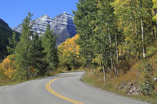 Maroon Creek Road with autumn aspen trees in Maroon Bells Valley, near Aspen, Colorado, USA