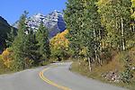 Maroon Creek Road with autumn aspen trees in Maroon Bells Valley, near Aspen, Colorado, USA