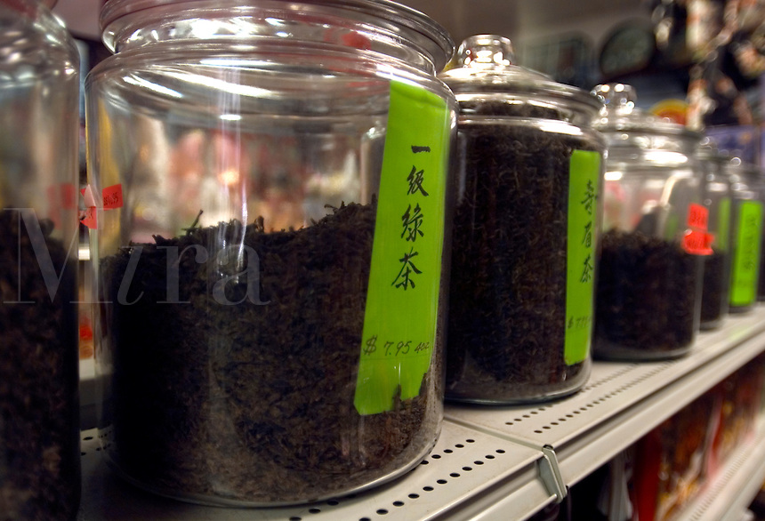 Glass jars of black tea