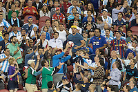 Santa Clara, CA - Monday June 6, 2016: A fan catches a ball hit into the stands. Argentina played Chile in the group D match of the Copa América Centenario game at Levi's Stadium.