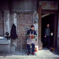 Chinese woman workers chat outside their launderette in Nanjing, Jiangsu province, 2012. (Mamiya 6, 75mm f3.5, Kodak Ektar 100 film)