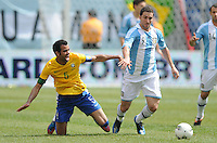 Argentina forward Gonzalo Higuain (9) goes against Brazil midfielder Sandro (5) The Argentina National Team defeated Brazil 4-3 at MetLife Stadium, Saturday July 9 , 2012.