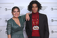 """New York CITY - JUNE 15: Paulina Alexis and D'Pharaoh Woon-A-Tai attend the Tribeca Festival screening of FX's """"Reservation Dogs"""" on June 15, 2021 in New York City. (Photo by Anthony Behar/FX/PictureGroup)"""