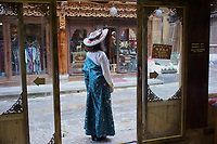 Diqing Tibetan Autonomous Prefecture, Yunnan Province, China - A Han Chinese woman tries on traditional Tibetan costumes, August 2018.