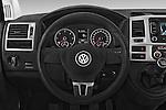 Car pictures of steering wheel view of a 2014 Volkswagen CARAVELLE COMFORTLINE 4 Door Passenger Van Steering Wheel