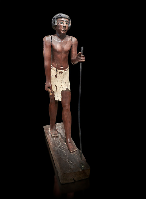 Ancient Egyptian wooden statue of Shemes,  Middle Kingdom (1980-1700 BC), tomb of Shimes, Asyut. Egyptian Museum, Turin. black background<br /> <br /> In 1908 in Asyut, Egypt an intact tomb was discovered of an official named Shemes, it contained many rich grave goods. Two rectangular Coffins, one for Shemes and the other for a woman called Rehuerausen, possibly his wife. They carry typical Middle Kingdom decorations,