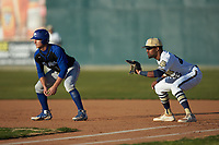 Queens Royals first baseman Noah Jones (23) keeps Troy Maslowski (16) of the Barton Bulldogs close to the bag at Intimidators Stadium on March 19, 2019 in Kannapolis, North Carolina. The Royals defeated the Bulldogs 6-5. (Brian Westerholt/Four Seam Images)