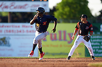 State College Spikes left fielder Vincent Jackson (40) keeps his eye on the ball while running the bases past second baseman Mike Garzillo (3) during a game against the Batavia Muckdogs on June 24, 2016 at Dwyer Stadium in Batavia, New York.  State College defeated Batavia 10-3.  (Mike Janes/Four Seam Images)
