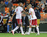 New York Red Bulls forward Thierry Henry (14) leaves the field in the second half while in the background DC United Head Coach Ben Olsen gives instructions to the team.    The New York Red Bulls defeated DC United 4-0, at RFK Stadium, Saturday April 21, 2011.