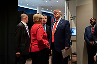 President Donald J. Trump meets informally with German Chancellor Angela Merkel and Argentine President Mauricio Macri Tuesday, September 24, 2019, as he prepares to leave the United Nations Headquarters in New York City. (Official White House Photo by Shealah Craighead)