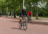 16th May 2020, London, England;  Cyclists cycling towards Buckingham Palace on the mall while not wearing gloves or a mask