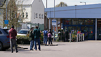 The public queue to enter supermarket as the weather remains warm during the Covid-19 Pandemic in which the Government have given strict rules on only leaving the home for essential work, food shopping and one form of exercise per day.<br /> The Rye Park in High Wycombe, Bucks on 5 April 2020. Photo by Andy Rowland.
