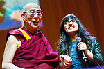 © Joel Goodman - 07973 332324 . 16/06/2012 . Manchester , UK .  SOPHIA SALEEM (right) , 15 , a pupil at Levenshulme High School , receives a Youth Award for Compassion from the DALAI LAMA . Saleem helped to tackle bullying and discrimination at school in her capacity as the head of the school's Youth Council . Stand Up and Be the Change youth event , hosted by the Dalai Lama during a 10 day UK tour , at the Manchester Arena . Photo credit : Joel Goodman