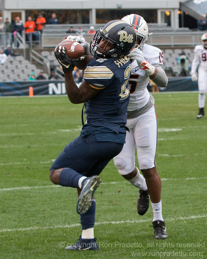 Pitt wide receiver Maurice Ffrench makes a catch and is tackled by Virginia defensive back De'Vante Cross (15). The Pitt Panthers defeated the Virginia Cavaliers 31-14 at Heinz Field, Pittsburgh, PA on October 28, 2017.