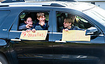 WATERTOWN, CT-123020JS09- Supporters wave and hold signs as they pass by during a send-off parade and ceremony in honor of Watertown Police Chief John Gavallas Wednesday at the Watertown Police Department. Chief Gavallas has served for 51 years. <br /> Jim Shannon Republican-American