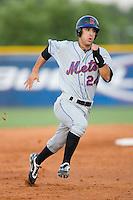 Ryan Molica #24 of the Kingsport Mets hustles towards third base versus the Burlington Royals at Burlington Athletic Park July 3, 2009 in Burlington, North Carolina. (Photo by Brian Westerholt / Four Seam Images)