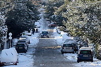 Pictured: A snow covered road in the Nea Erythrea area of Athens, Greece. Tuesday 08 January 2018<br /> Re: Heavy snowfall has affected most parts of Greece.