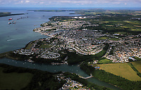 Pictured: Aerial view of Milford Haven, Pembrokeshire, west Wales. Monday 06 June 2011.<br /> Re: The four people killed in the explosion and fire at the Chevron oil refinery in Pembrokeshire have been named.<br /> They were Julie Jones, 54, a fire guard from Pembroke, and three men from Milford Haven: Dennis Riley, 52, Robert Broome, 48, and Andrew Jenkins, 33.<br /> Ms Jones was a mother of one and grandmother, Mr Riley a father of two and grandfather, Mr Broome a father of seven and Mr Jenkins had young twins.<br /> A fifth person is critical but stable after Thursday's blast at Pembroke.<br /> Churches are opening their doors to allow people to say prayers for the victims, with books of condolence available and priests offering support.<br /> <br />  <br /> It could be some time before the cause of the explosion is known Dyfed-Powys Police said the bodies were removed from the scene on Friday night.