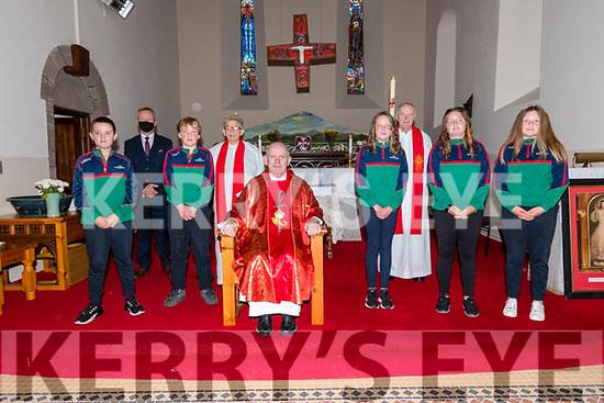 Pupils from Scoil Mhaolchéadair Darragh Ruiséal, Dónal Ó Laighin, Ríona Bacaéir, Caroline Ní Dhubhda and Ellie Ní Fhloinn the day of their Confirmation, here pictured with their muinteoir Sean Ó Beaglaoich, An tAthair Micheal Ó Muíneachain, an tAthairTomas Ó hIcí and an tAthair Eoghan Ó Cadhla at Séipéal na Carraige on Friday.