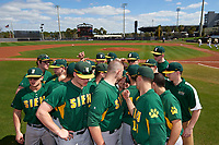 Siena Saints team huddle before a game against the UCF Knights on February 21, 2016 at Jay Bergman Field in Orlando, Florida.  UCF defeated Siena 11-2.  (Mike Janes/Four Seam Images)