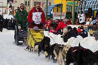 2010 Iditarod Ceremonial Start in Anchorage Alaska musher # 13 SCOTT WHITE with Iditarider DIANE WEST