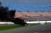 The #67 Krohn/TRG Pontiac/Riley catches fire and burns in the tri-oval