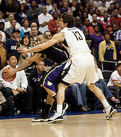 Nikola Knezevic (13) picks up the foul defending Venoy Overton in the final seconds of the game. The Washington Huskies defeated the California Golden Bears 79-75 during the championship game of the Pacific Life Pac-10 Conference Tournament at Staples Center in Los Angeles, California on March 13th, 2010.