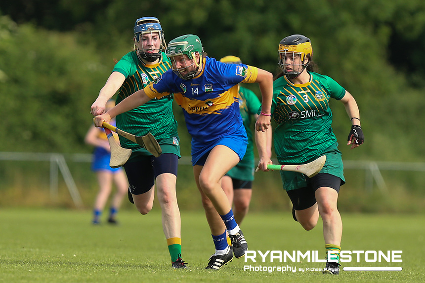 Tipperary's Cait Devane in action against Claire Coffey and Grace Coleman of Meath during the Liberty Insurance All Ireland Senior Camogie Championship Round 1 between Tipperary and Meath at the Ragg, Co Tipperary. Photo By Michael P Ryan.