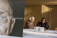 """Freiluftausstellung """"Gegen das Vergessen"""" in Berlin-Mitte.<br /> Mehr als 200 Ueberlebenden begegnete Fotograf und Filmemacher Luigi Toscano in den vergangenen zwei Jahren. Dafuer reiste er quer durch Deutschland, Russland, Ukraine, Israel und in die USA. Jetzt werden die Portraets von 50 Ueberlebenden erstmals in Berlin gezeigt. Vom vom 9. November zum 26.November 2017 ist das einmalige erinnerungspolitische Kunst- und Kulturprojekt """"Gegen das Vergessen"""" auf dem Gelaende der Sophienkirche zu sehen.<br /> Im Bild vlnr.: Die Berliner Ueberlebende Margot Friedlander und der Fotograf und Filmemacher Luigi Toscano. Im Vordergrund der Bildband zum Fotoprojekt.<br /> 7.11.2017, Berlin<br /> Copyright: Christian-Ditsch.de<br /> [Inhaltsveraendernde Manipulation des Fotos nur nach ausdruecklicher Genehmigung des Fotografen. Vereinbarungen ueber Abtretung von Persoenlichkeitsrechten/Model Release der abgebildeten Person/Personen liegen nicht vor. NO MODEL RELEASE! Nur fuer Redaktionelle Zwecke. Don't publish without copyright Christian-Ditsch.de, Veroeffentlichung nur mit Fotografennennung, sowie gegen Honorar, MwSt. und Beleg. Konto: I N G - D i B a, IBAN DE58500105175400192269, BIC INGDDEFFXXX, Kontakt: post@christian-ditsch.de<br /> Bei der Bearbeitung der Dateiinformationen darf die Urheberkennzeichnung in den EXIF- und  IPTC-Daten nicht entfernt werden, diese sind in digitalen Medien nach §95c UrhG rechtlich geschuetzt. Der Urhebervermerk wird gemaess §13 UrhG verlangt.]"""