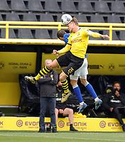 16th May 2020, Signal Iduna Park, Dortmund, Germany; Bundesliga football, Borussia Dortmund versus FC Schalke; Borussia Dortmunds Lukasz Piszczek wins the header