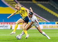 SOLNA, SWEDEN - APRIL 10: Magdalena Eriksson #6 of Sweden is defended by Lynn Williams #6 of the USWNT during a game between Sweden and USWNT at Friends Arena on April 10, 2021 in Solna, Sweden.